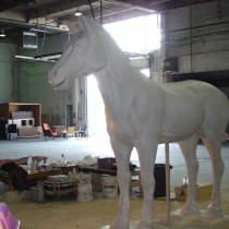 Here the finished sculpture of the larger size horse ready to be molded. This type of horse was accompanying Jet Lee's sculpture on the Chariot. Four (4) of this type were made. Sculptors: Lucie Fournier, Chantal Deshaies and Linda Bicari. Sculpture in styro, finition in plaster, molded and casted in plaster