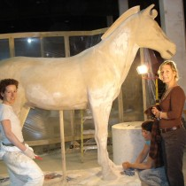 Here we are sculpting the the larger size horse which will accompany Jet Lee's sculpture on the Chariot. Four (4) of this type were made. Sculptors: Lucie Fournier, Chantal Deshaies and Linda Bicari. Sculpture in styro, finition in plaster, molded and casted in plaster
